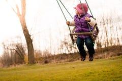 Swinging child Stock Photo