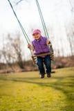 Swinging child Stock Images