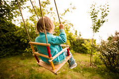 Swinging child Stock Image