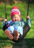 Swinging child Royalty Free Stock Photography
