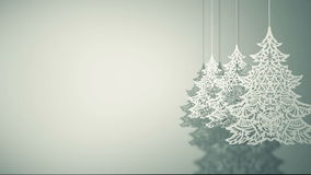 Swinging Christmas trees paper decorations stock footage