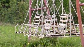 Swinging empty swings stock video footage