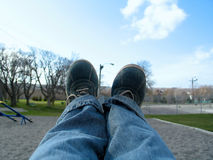 Swinging Feet Stock Photo