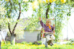 Swinging  girl Stock Photos