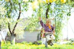 Swinging girl stock photos