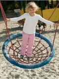 Swinging girl Royalty Free Stock Photography