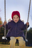 Swinging girl Stock Images