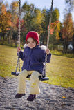 Swinging girl royalty free stock images