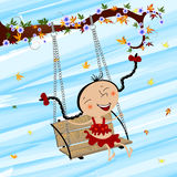 Swinging girl Stock Photo
