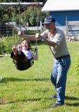 Swinging with Grandpa Royalty Free Stock Image
