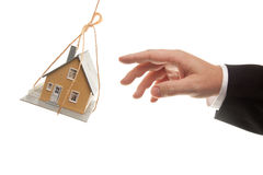 Swinging House and Business Man's Hand Stock Photo