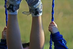 Swinging Legs. Child on swing with legs in the air Stock Photos