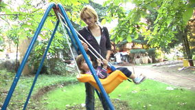 Swinging With Mom stock video footage