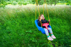 Swinging outdoors in garden stock images
