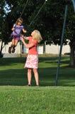 Swinging in the park Stock Photo