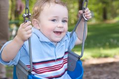 Swinging At The Park Royalty Free Stock Photography