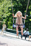 Swinging preschooler girl Royalty Free Stock Images