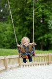 Swinging preschooler having fun Stock Photo