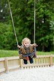 Swinging preschooler having fun Stock Photo