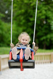 Swinging preschooler having fun Stock Photos