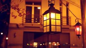 Swinging retro lamp at night. stock footage