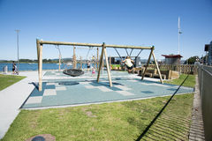 Swinging on Tauranga's waterfront, New Zealand. Stock Image