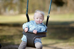 Swinging toddler having fun Stock Images