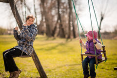 Swinging together - mother and baby Royalty Free Stock Photography