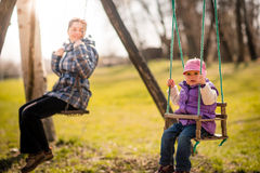 Swinging together - mother and baby Stock Photo