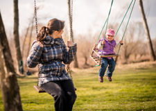 Swinging together - mother and baby Royalty Free Stock Images
