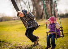 Swinging together - mother and baby Stock Photography