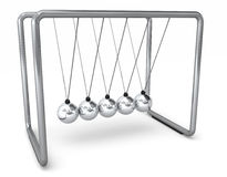 Swinging Toy. A Newton's Cradle swinging toy demonstrates the laws of physics Stock Photography