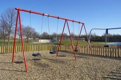 Swings. Children's swings in public park, UK Royalty Free Stock Images
