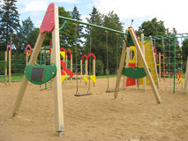 Swings. The children playground with different attractions Royalty Free Stock Photos