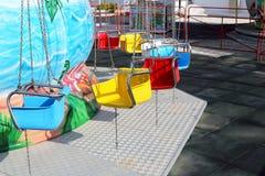 Swings in Amusement Park. Colorful Swings in Amusement Park Stock Photo