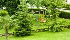 Swings in the backyard. Children swings in a backyard Stock Photo