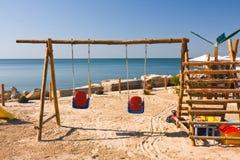 Swings on the beach Royalty Free Stock Photos