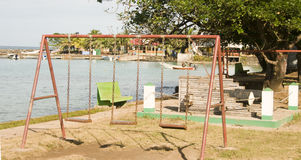 Swings children's park Brig Bay Corn Island. Children's park swing set old fashioned waterfront Brig Bay Corn Island Nicaragua royalty free stock photography