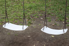 Swings for children under the tree Stock Photography