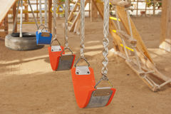 Swings in a childrens play area Stock Image