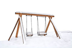Swings covered with snow Stock Photos
