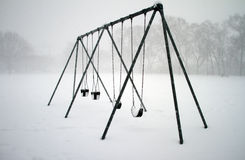 Swings covered with snow Royalty Free Stock Images