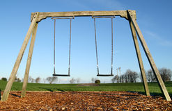 swings för barn s Royaltyfri Bild