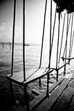 Swings by the ocean Stock Photography