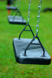 Swings at the park. Swings royalty free stock photos