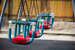 Swings in the park with chains Stock Photos