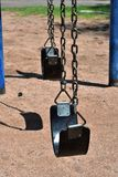 Swings at a park royalty free stock images