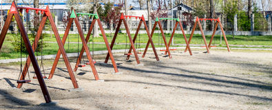 Swings in the park. Spring time Royalty Free Stock Photography