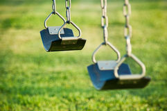 Swings at the playground. Swings with shallow depth of field at the playground Stock Image