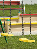 Swings on the playground Royalty Free Stock Photography